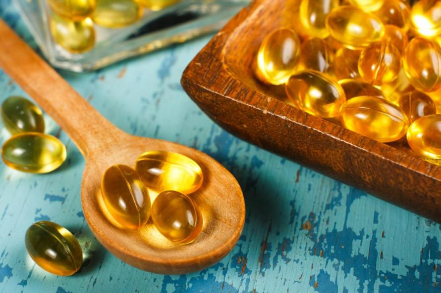 fish-oil-supplements-on-blue-background.jpg